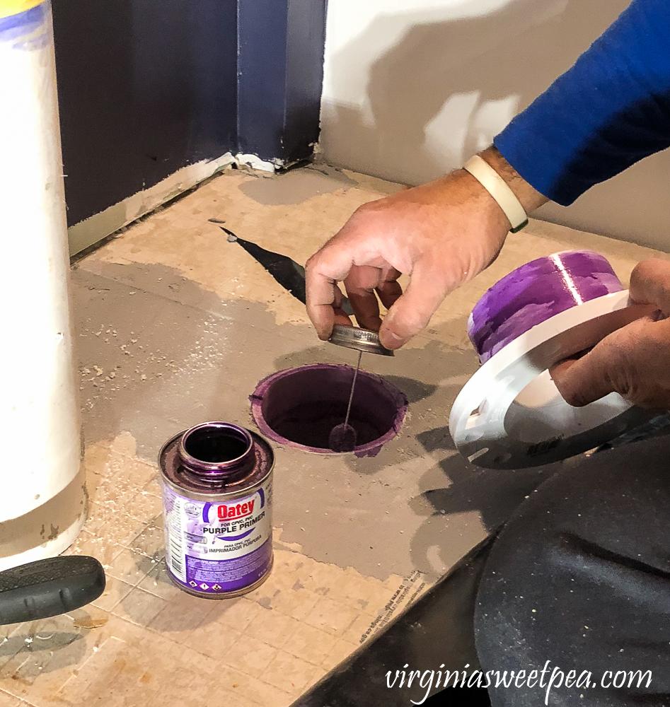 Preparing a toilet flange for flooring.