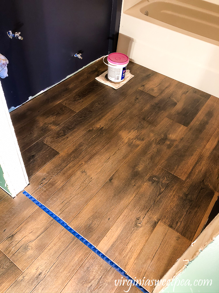 Mohawk Crest Loft flooring in Prairie Oak and Sherwin Williams Emerald Paint in Charcoal Grey