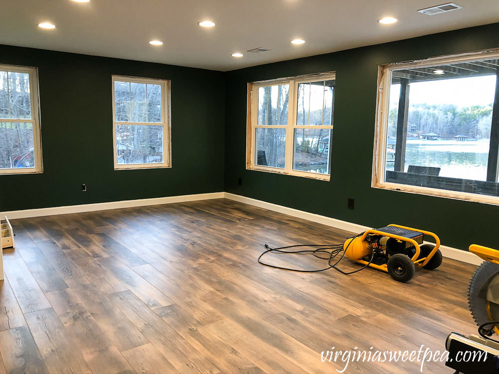 Lake House Basement Project - Family room painted with Sherwin Williams Rock Garden. #sherwinwilliams #culturedpearl #finishingabasement #basementproject