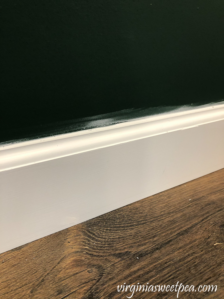 Caulking smear above baseboard
