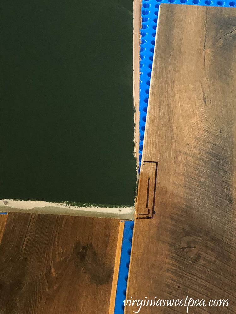 How to cut a vinyl floor plank around a door opening.