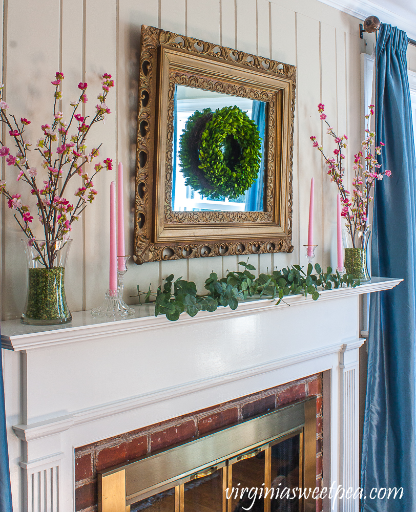 Mantel decorated for spring with pink and green