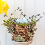 Spring nest made with a paper bag and embellished with moss, twigs, and lichen.