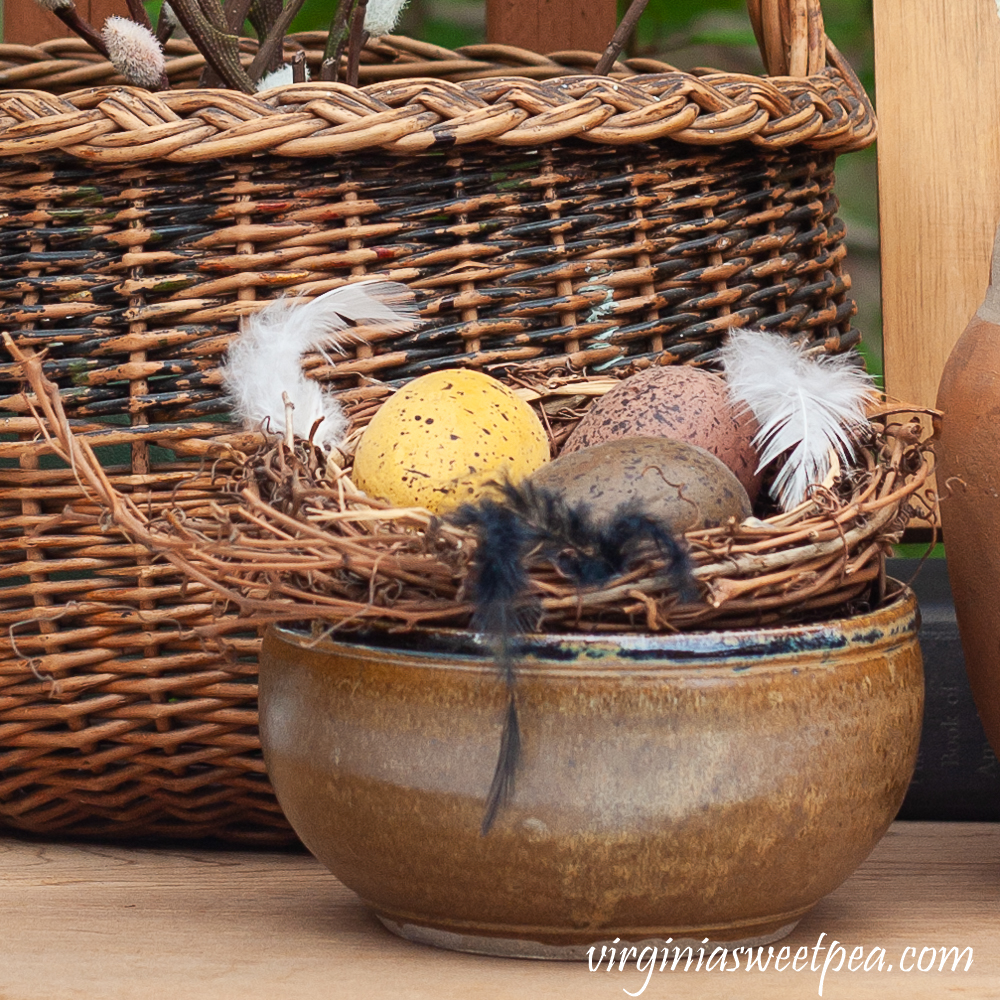 Nests with eggs in a pottery bowl