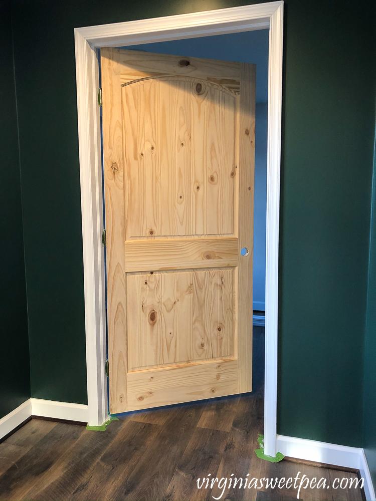 Trim painted around a wood door