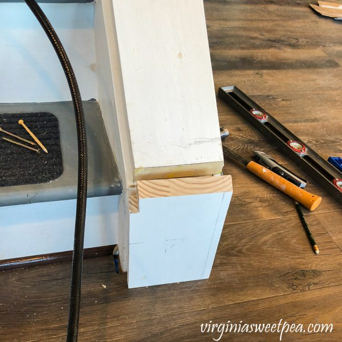 Installing a newel post at the bottom of a set of stairs