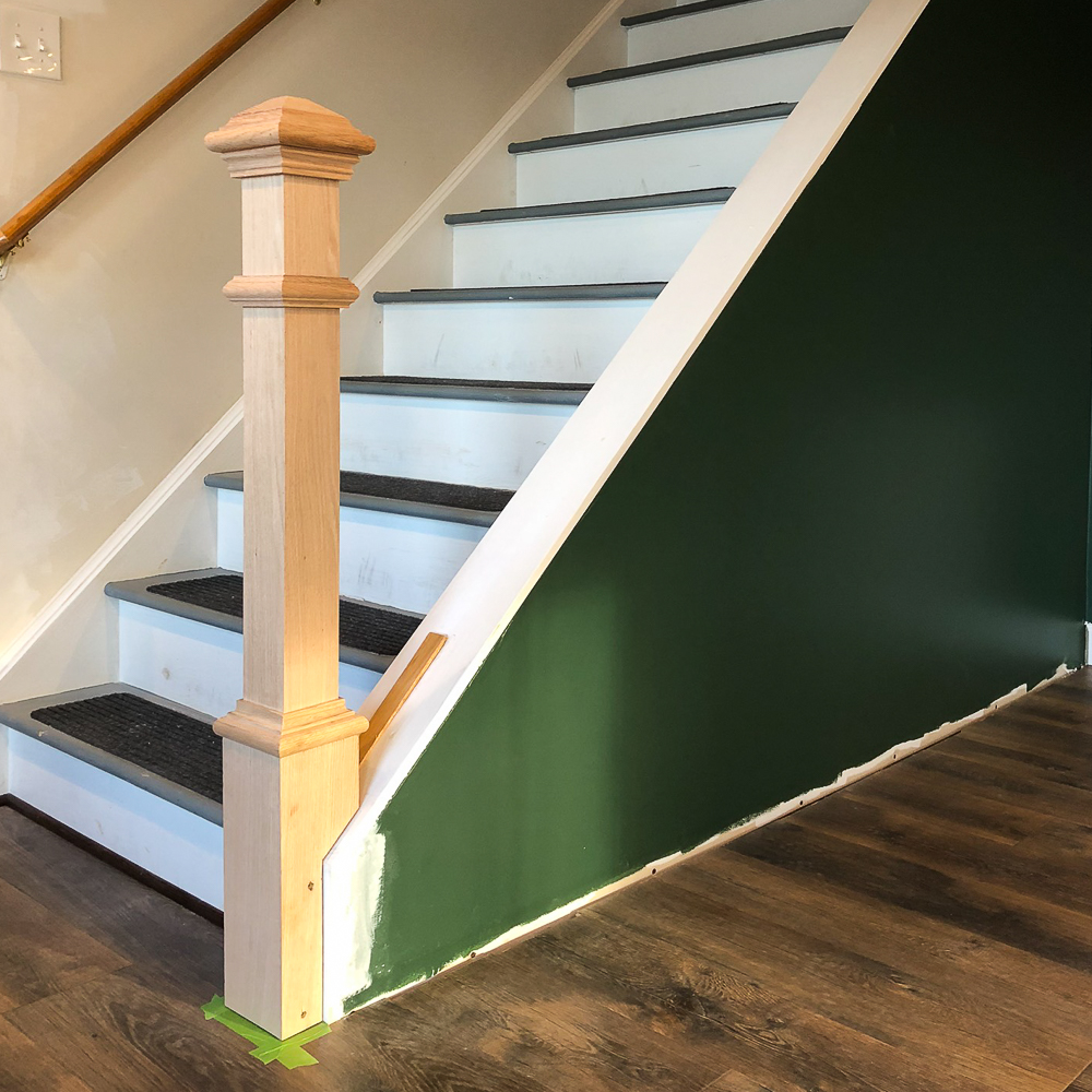 Newel post at the base of a set of stairs
