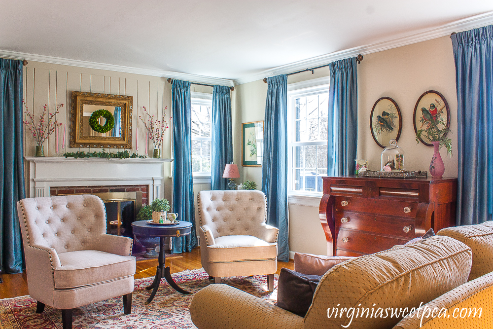 Living room decorated for spring with pink and green