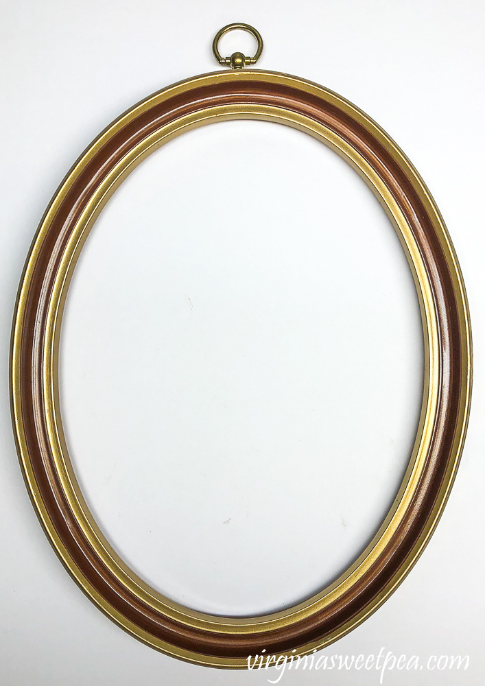 oval brass and brown picture frame