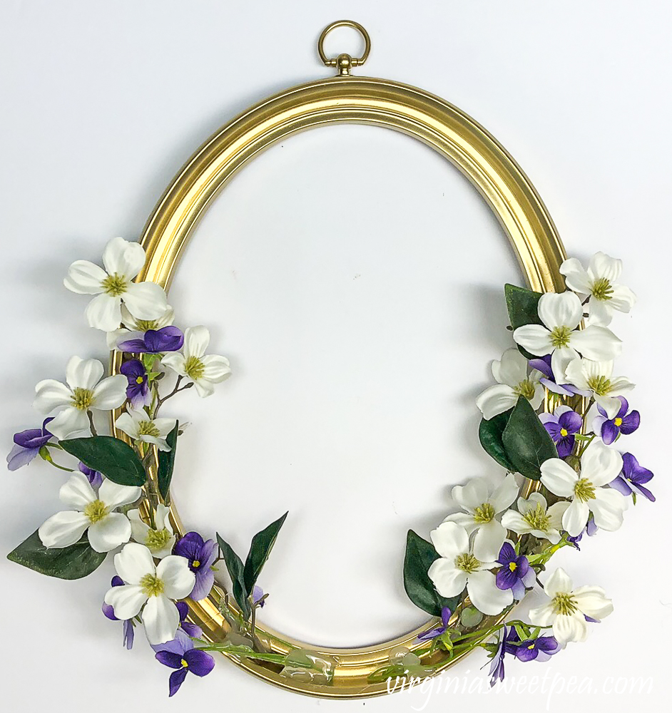 Faux dogwood and viola on a picture frame