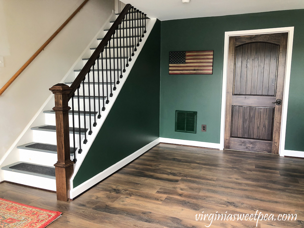 Staircase with metal balusters and a handmade wood American flag