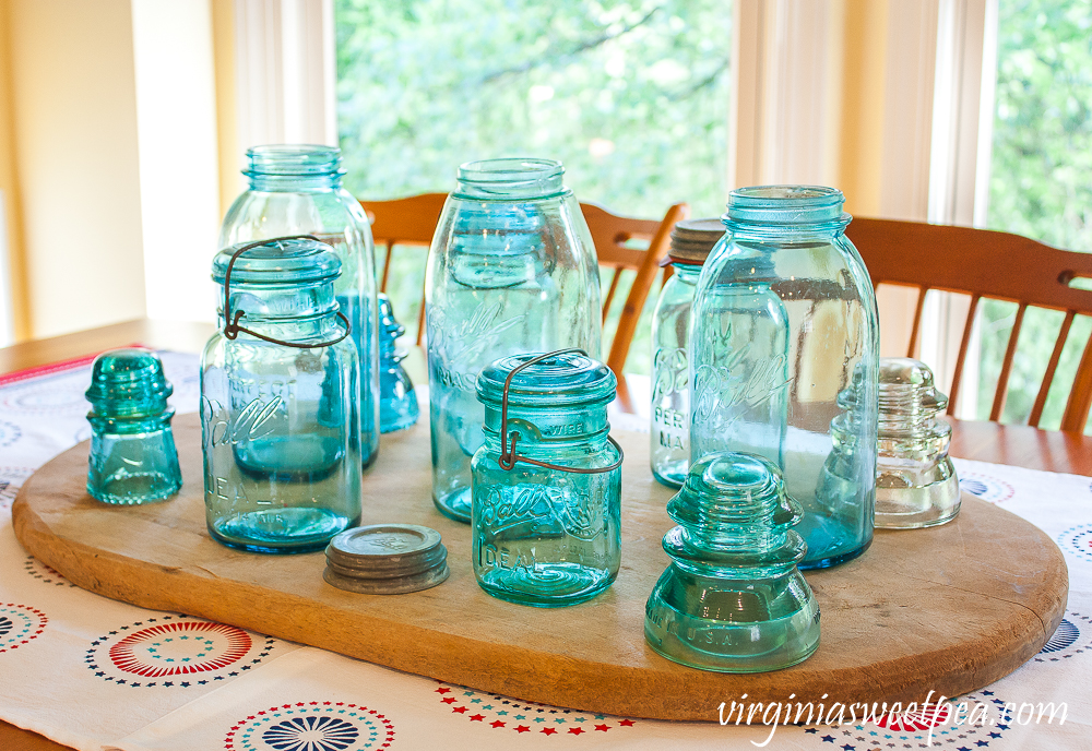 Centerpiece with Vintage Ball Jars and Insulators
