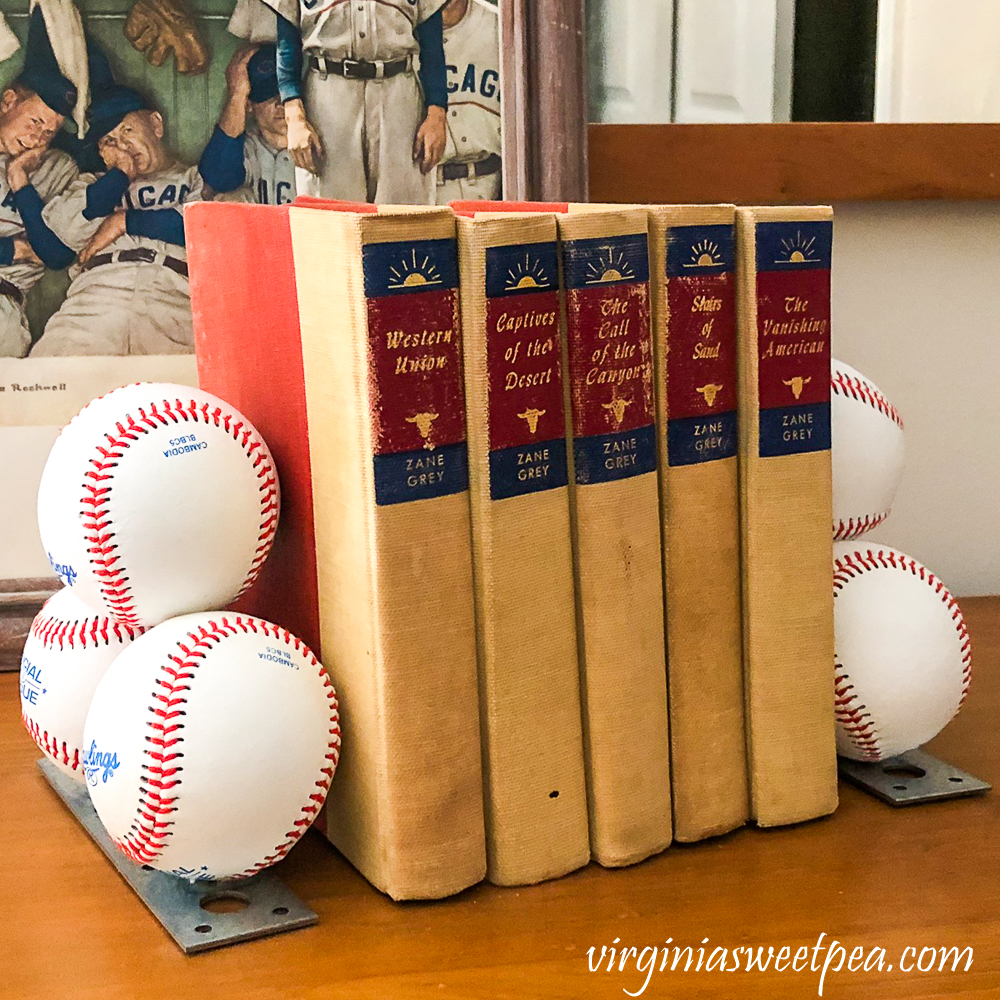 Bookends made with baseballs holding a collection of Zane Grey books