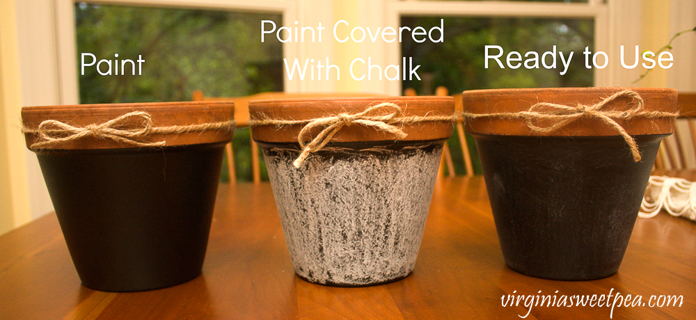 three pots painted with chalkboard paint