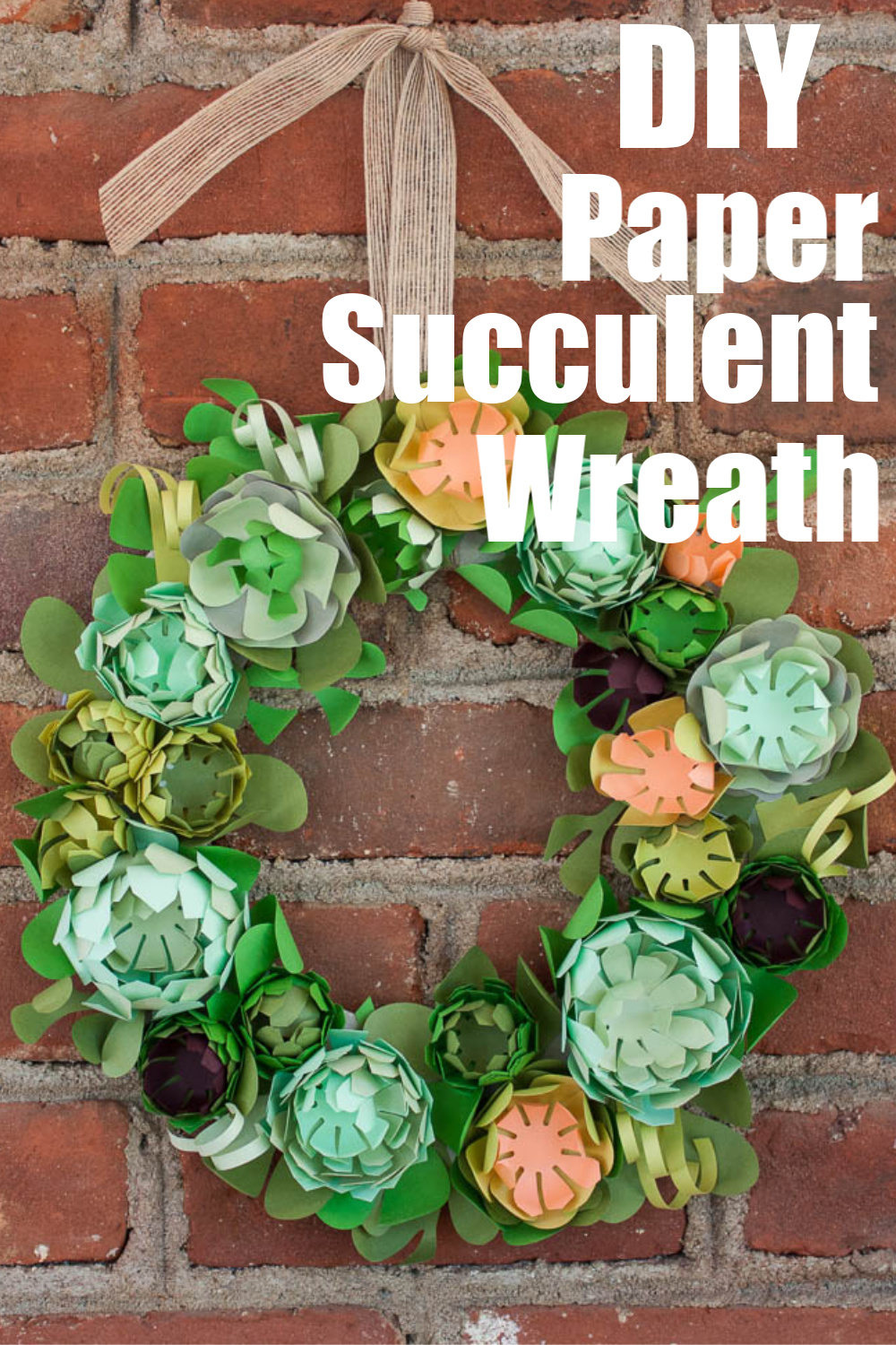 DIY Paper Succulent Wreath - This beautiful wreath was crafted from paper. #succulentwreath #wreath #wreathidea via @spaula