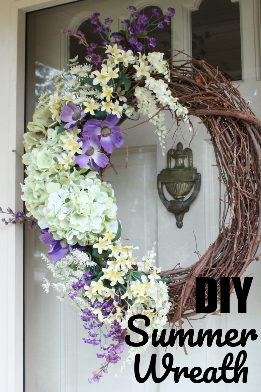 DIY Summer Wreath - Faux floral stems in white, purple, and pale yellow adorn a wreath for summer. #summerwreath #wreath #wreatidea via @spaula