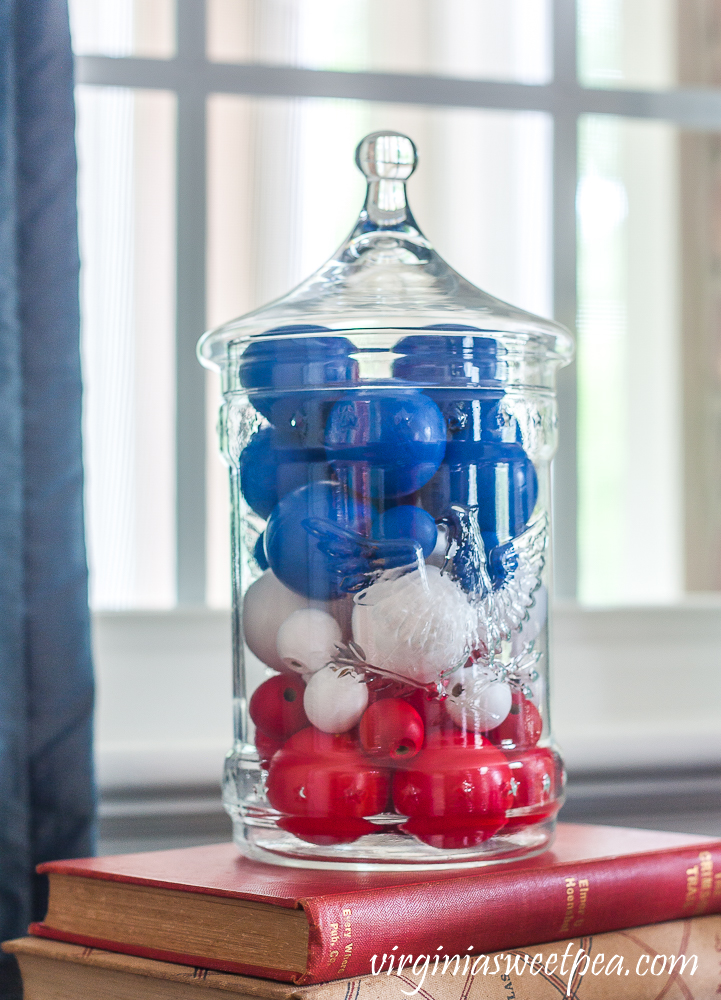 Patriotic Vignette with 1976 eagle jar with red, white, amd blue filler made from wood beads and ping-pong balls