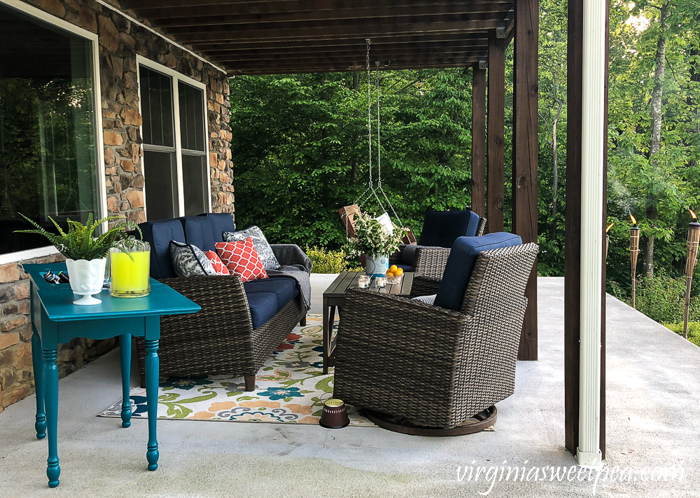 Lake house patio with furniture and a sewing table upcycled into an outdoor bar