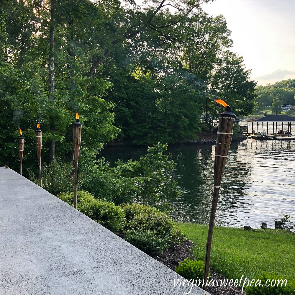 Tiki torches lit besides a patio on Smith Mountain Lake