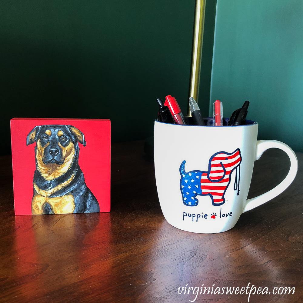 Oil painting of Sherman Skulina with a Puppy Love Mug filled with Pens