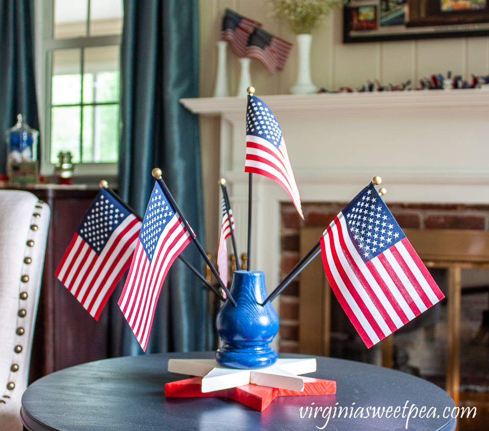 Flag Display holding six American flags with a two wooden star base.