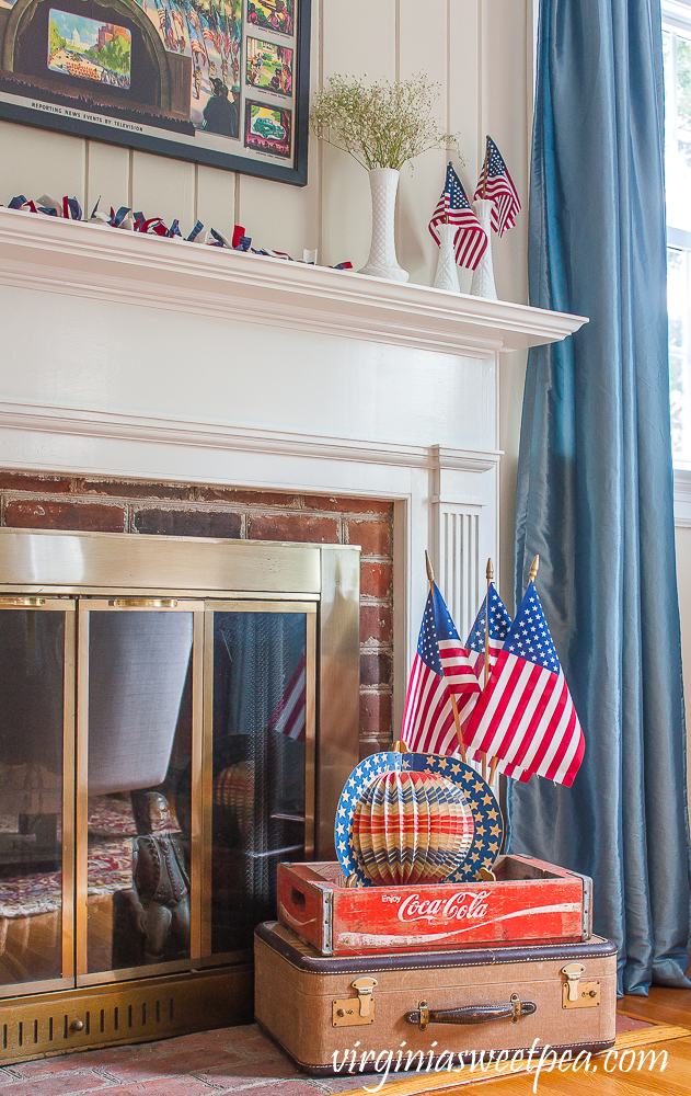 Living room and mantel decorated patriotically with vintage.