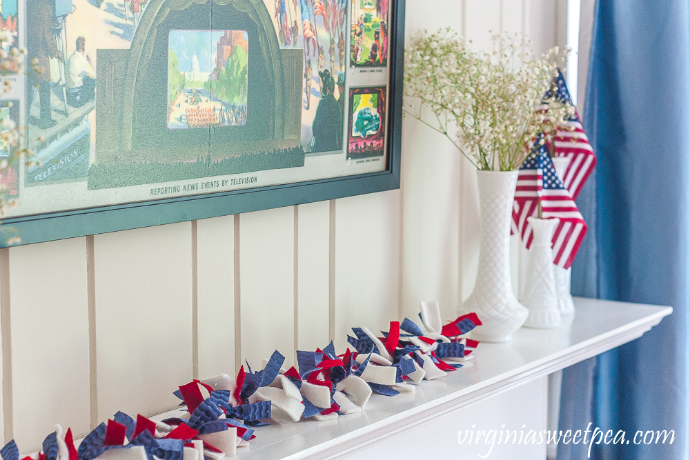 Patriotic rag garland made with blue quilting fabric, red wool, and white fleece