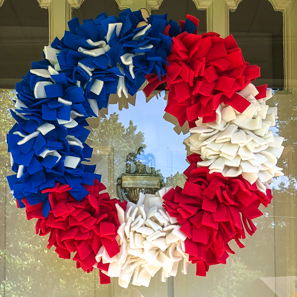 Red, white, and blue wreath made with fleece strips.