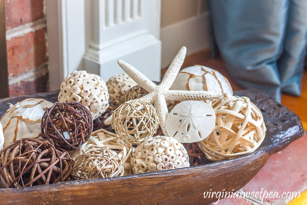 Dough bowl decorated with woven spheres and a starfish and sand dollar.