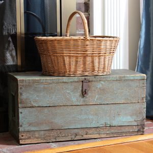 Vintage toolbox with a vintage basket on top of it.