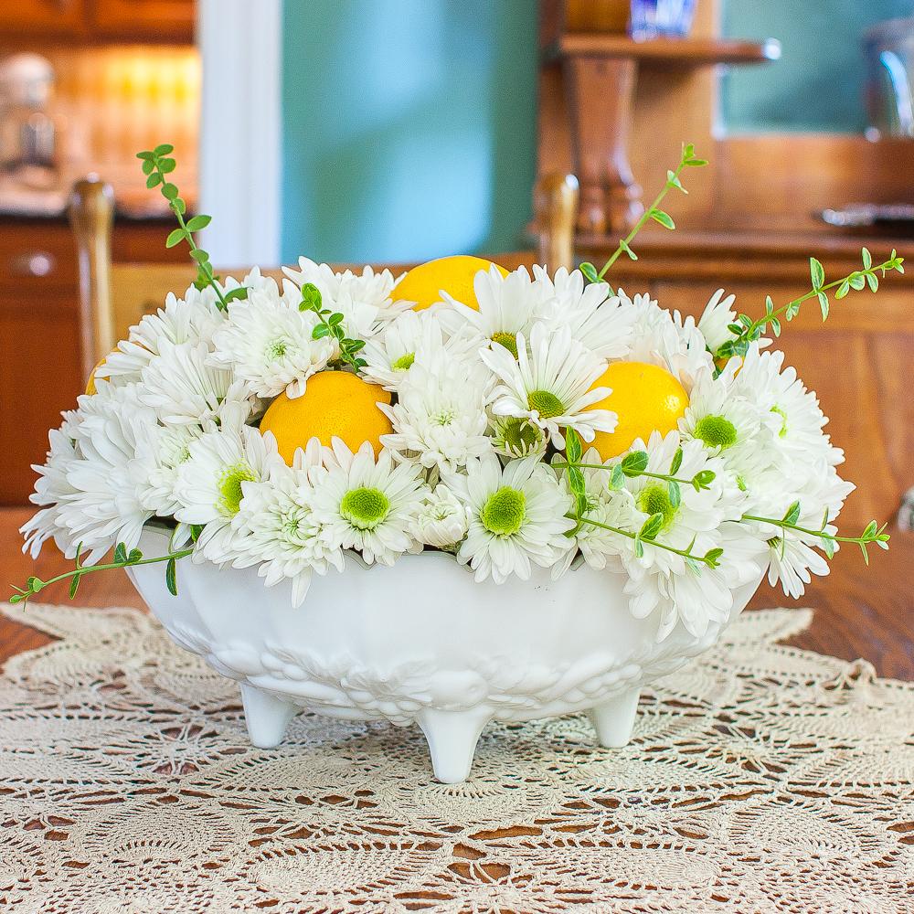 Summer flower arrangement with Chrysanthemums and lemons