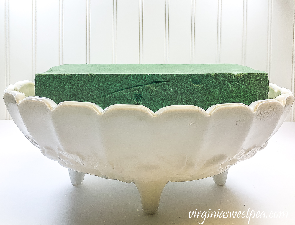 Oasis in a milk glass Indiana fruit bowl