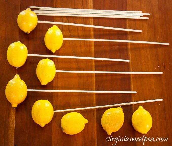 Lemons on a skewer for a flower arrangement