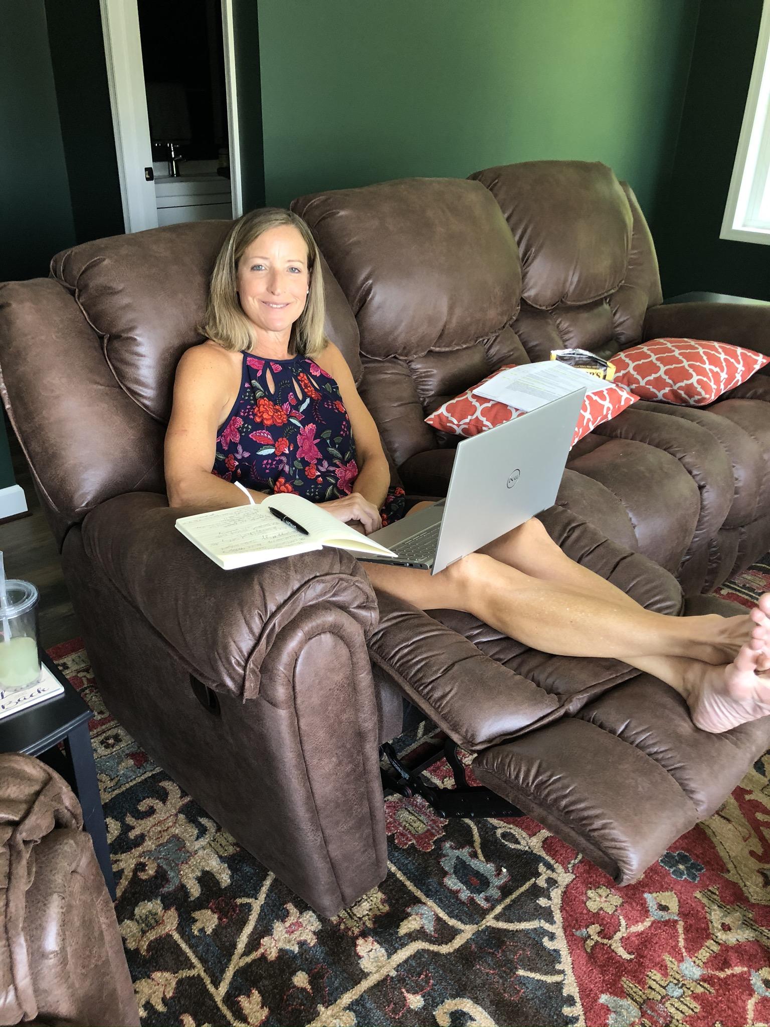 Paula Skulina blogging from a Homestretch sofa recliner