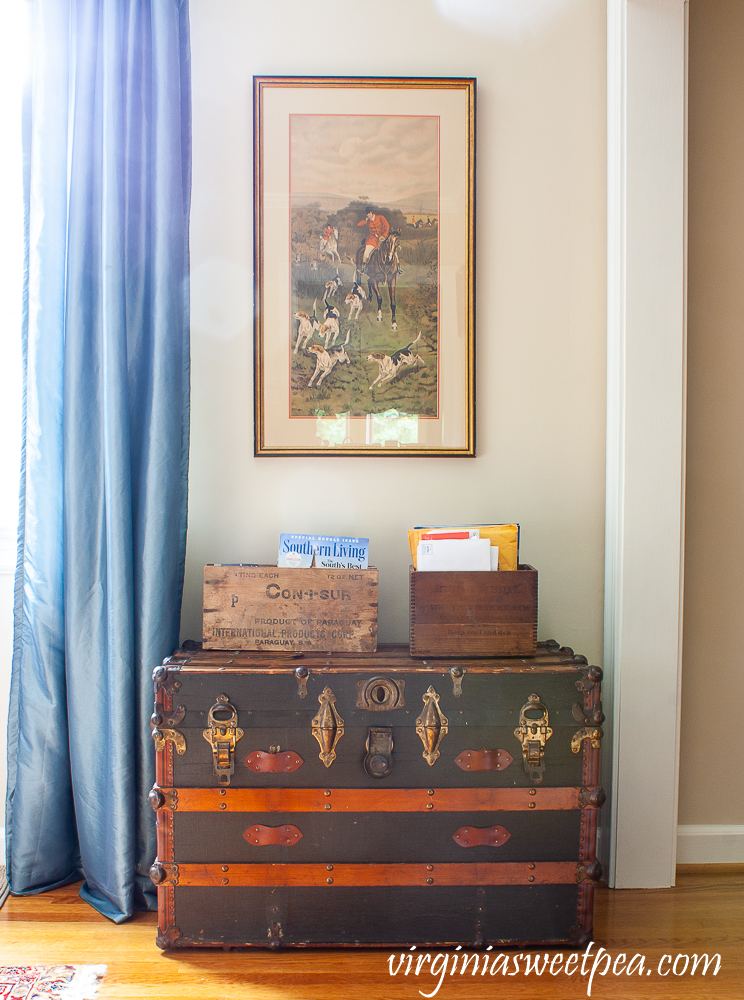 Vintage trunk with two crates used to organize mail.
