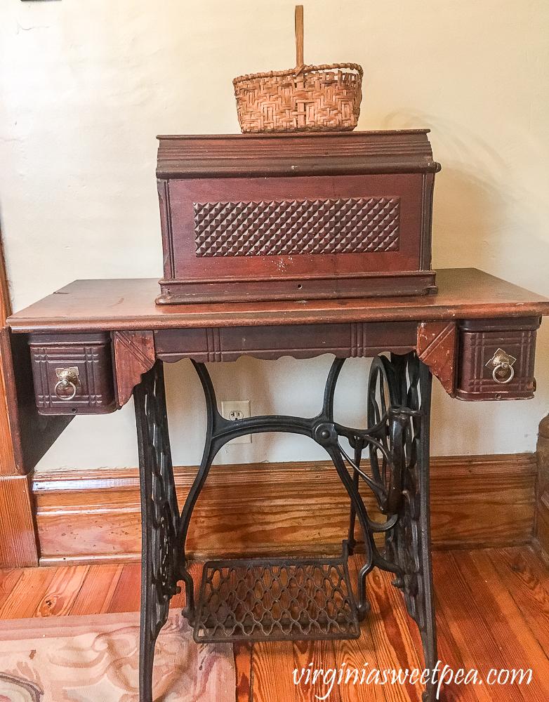 Vintage Basket on top of a vintage sewing machine.