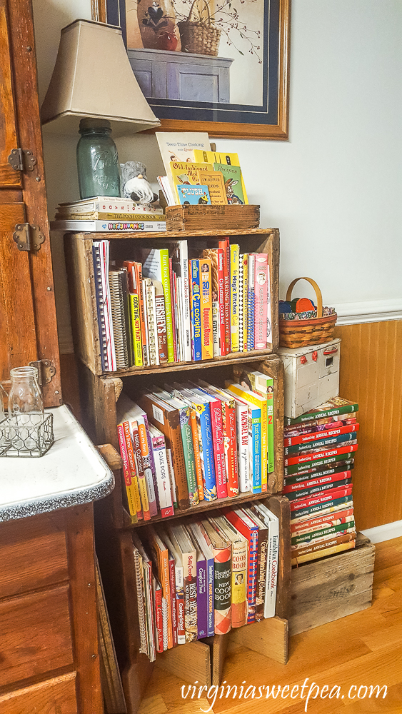 Stacked vintage crates filled with cookbooks