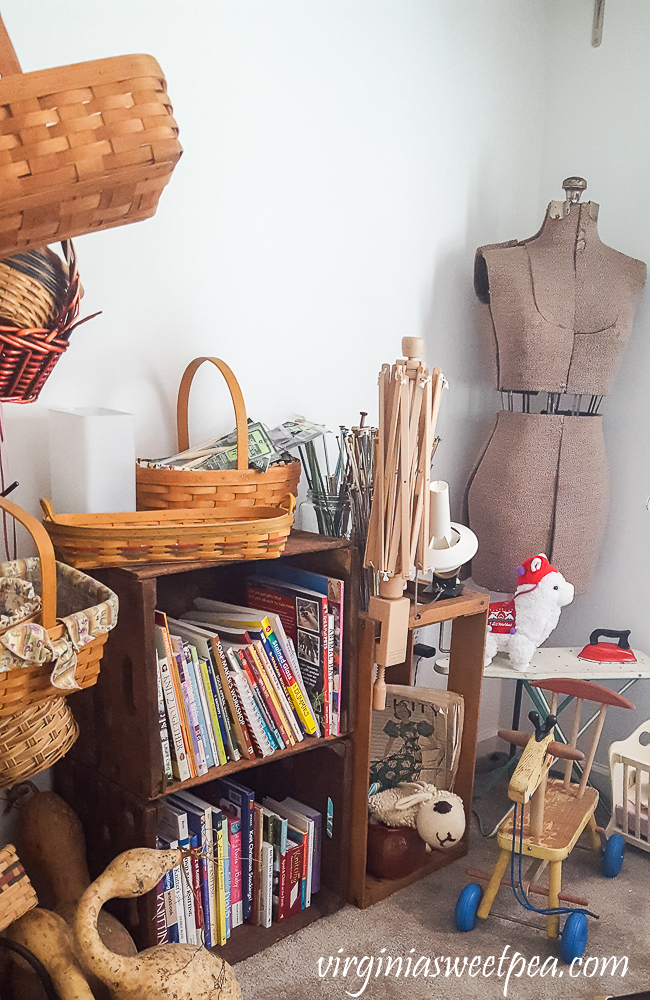 Crates and baskets in a sewing room.