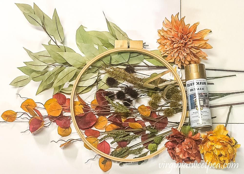 Supplies to make a fall hoop wreath
