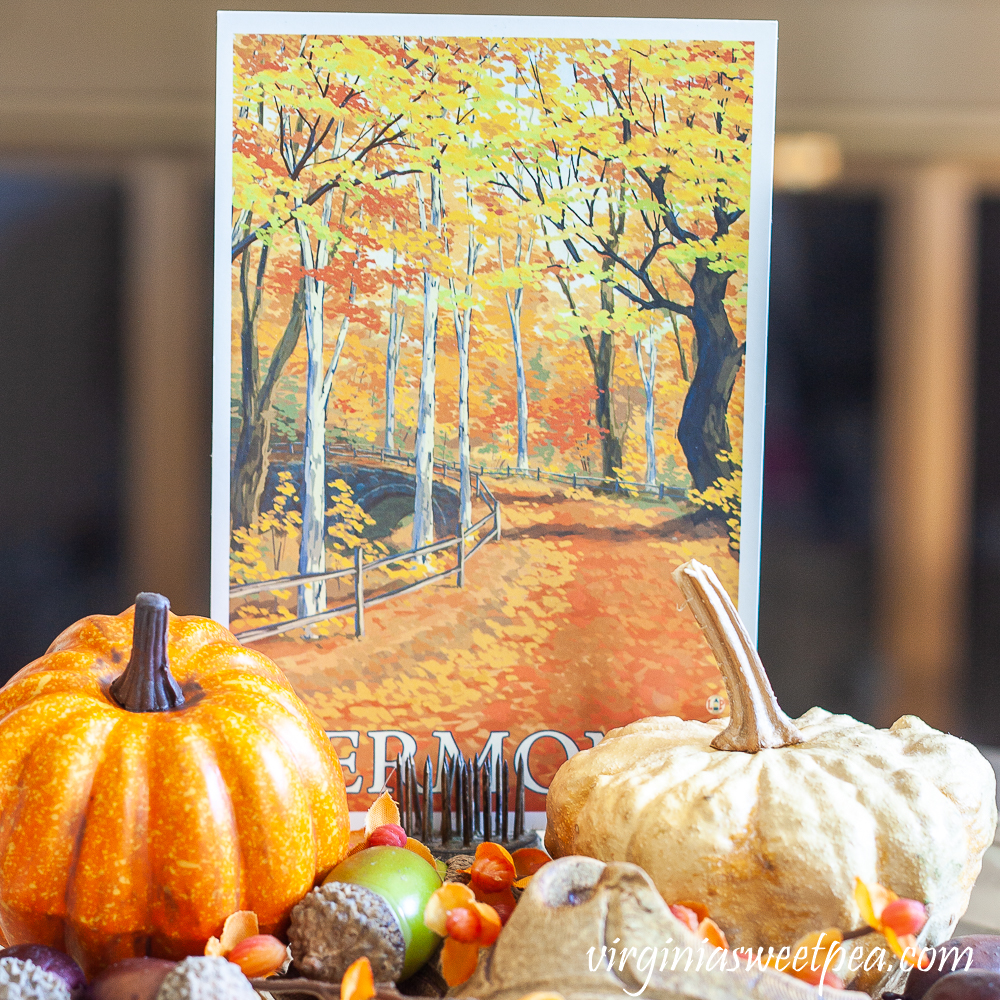 Fall Vermont postcard with a faux pumpkin, preserved gourd, acorns, and bittersweet