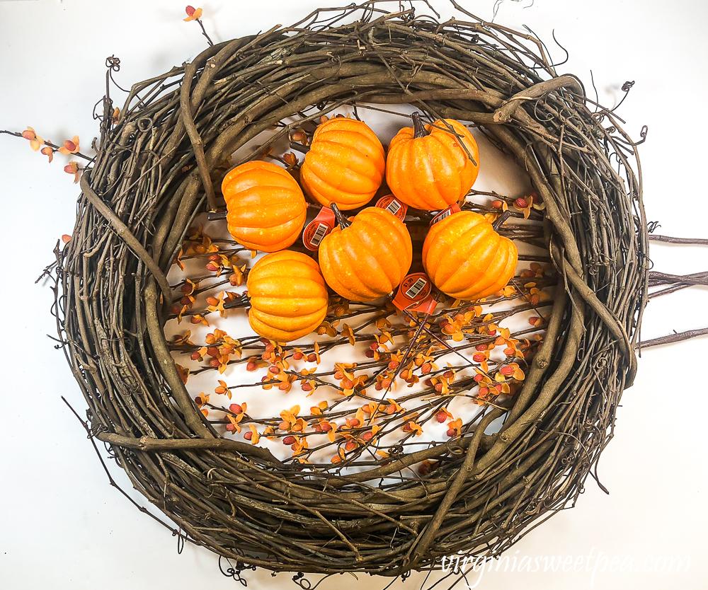 Grapevine wreath, pumpkin picks, and bittersweet pieces