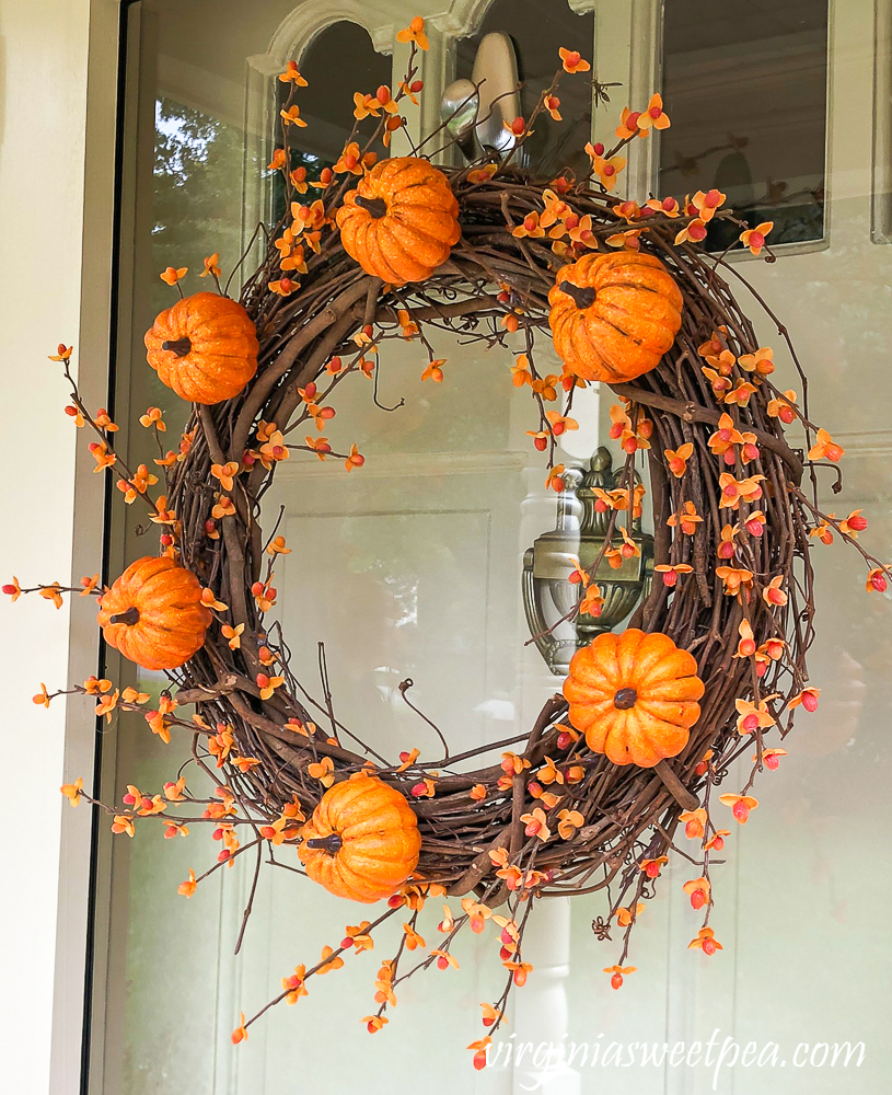 Grapevine wreath for fall with pumpkins and bittersweet
