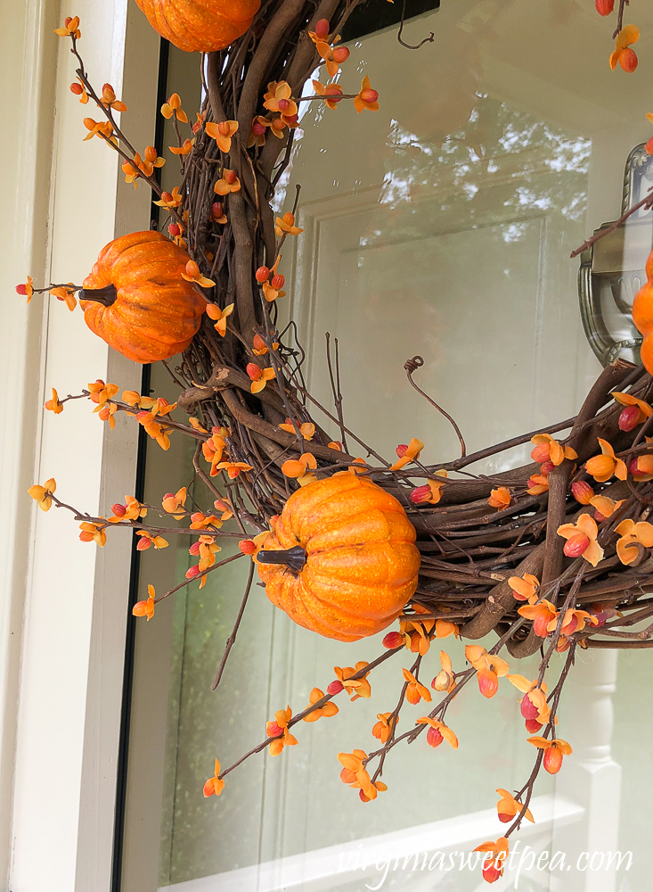 Pumpkin picks and faux bittersweet on a grapevine wreath
