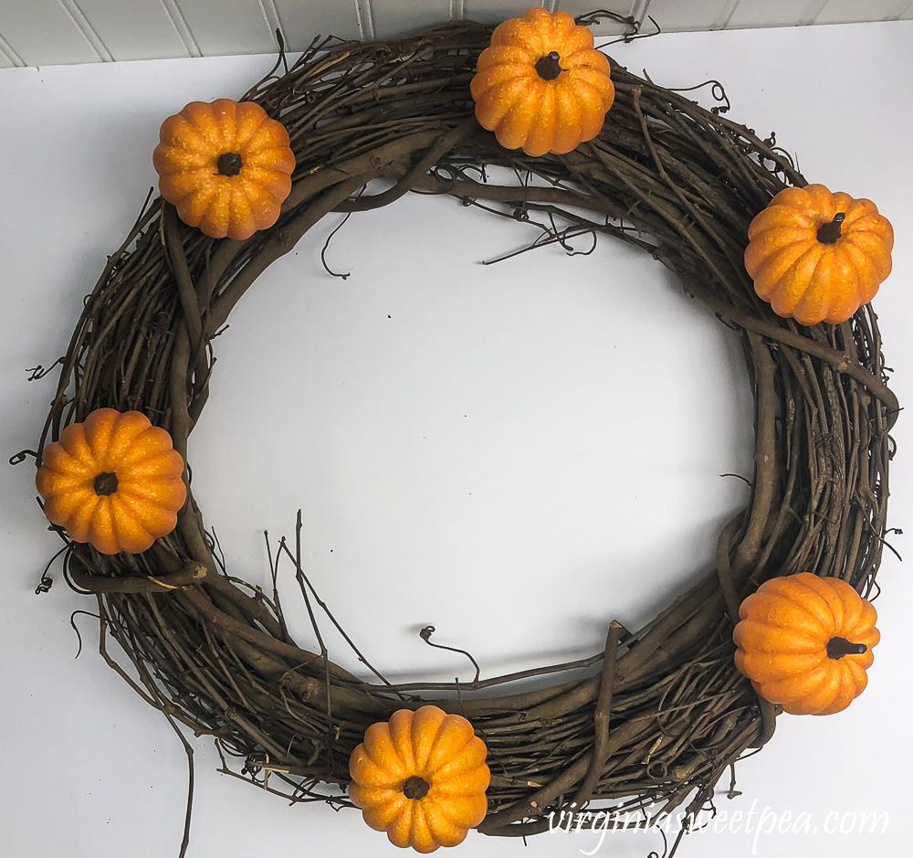Grapevine wreath with six pumpkins