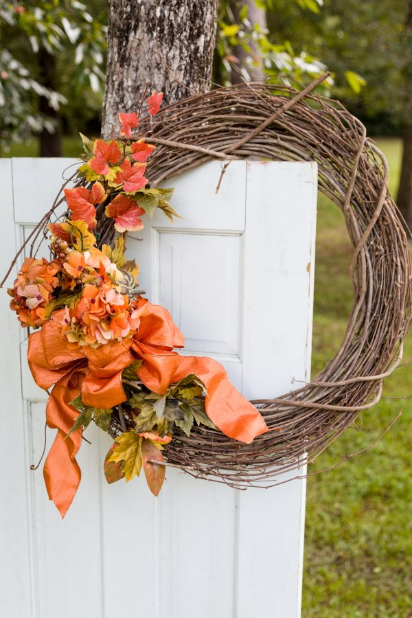 Fall wreath with fall foliage and an orange bow
