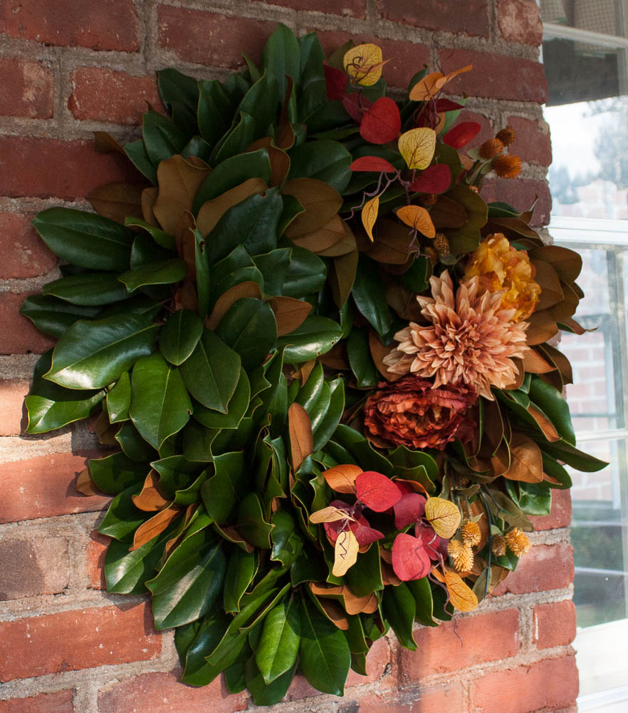Magnolia wreath decorated with fall florals