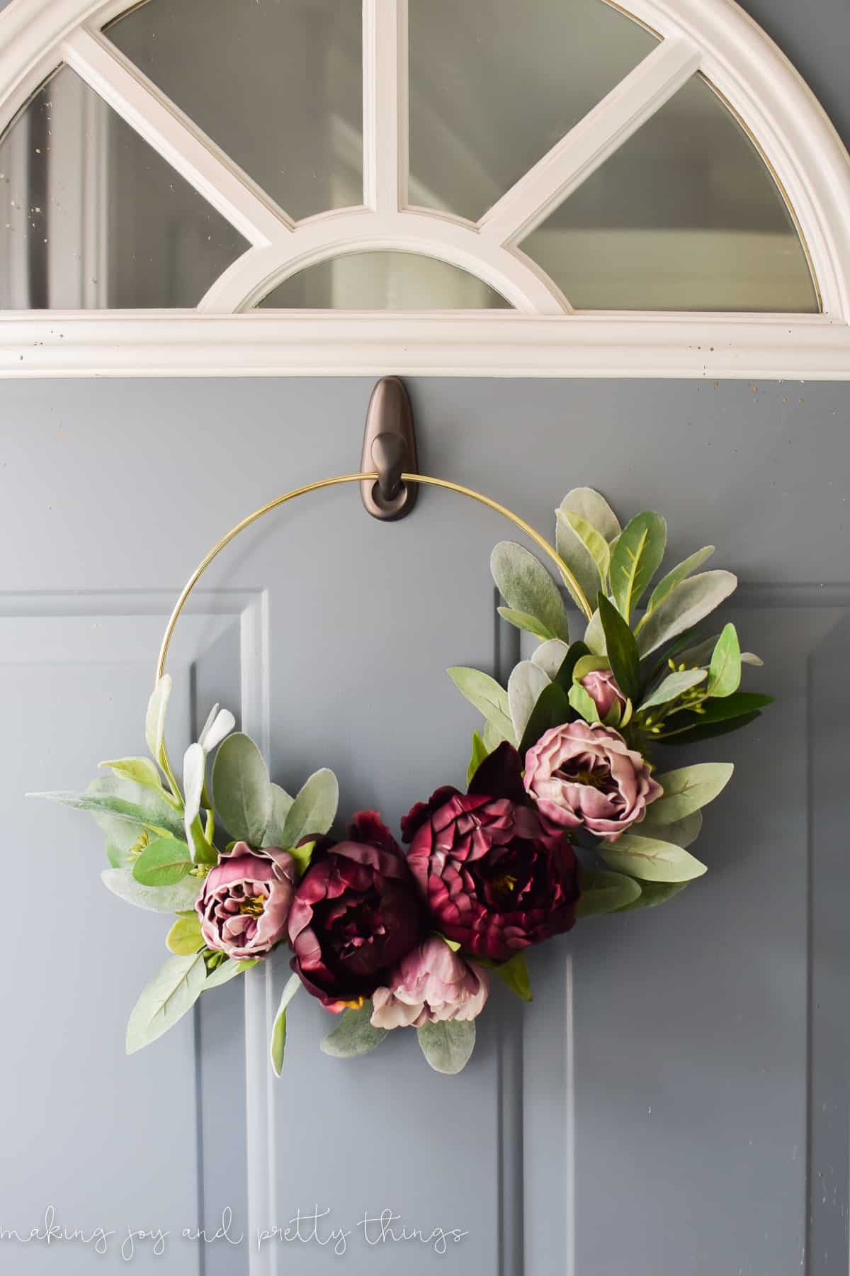 Fall hoop wreath with purple flowers and greenery