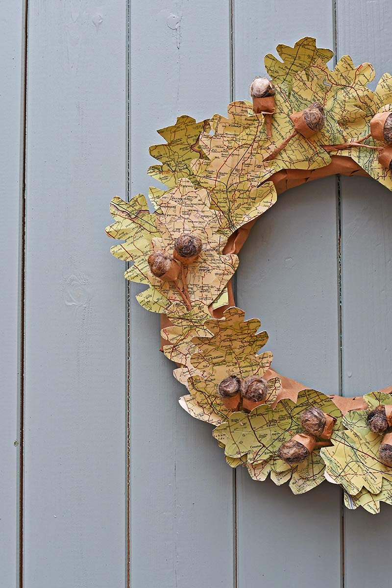 Fall wreath decorated with leaves made from maps