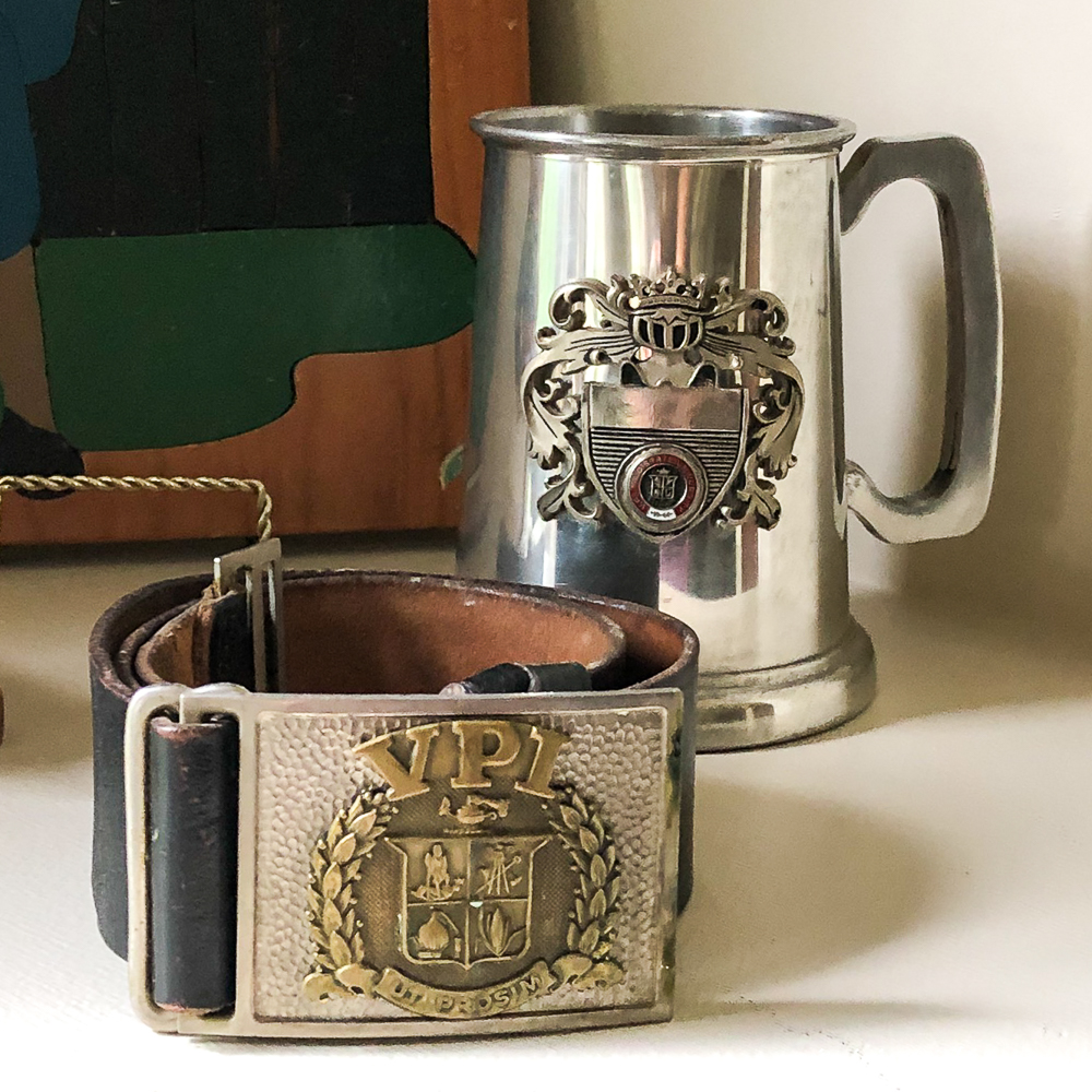 Virginia Tech corp of cadets belt with belt buckle from the late 50s to early 60s with a Virginia Tech metal mug
