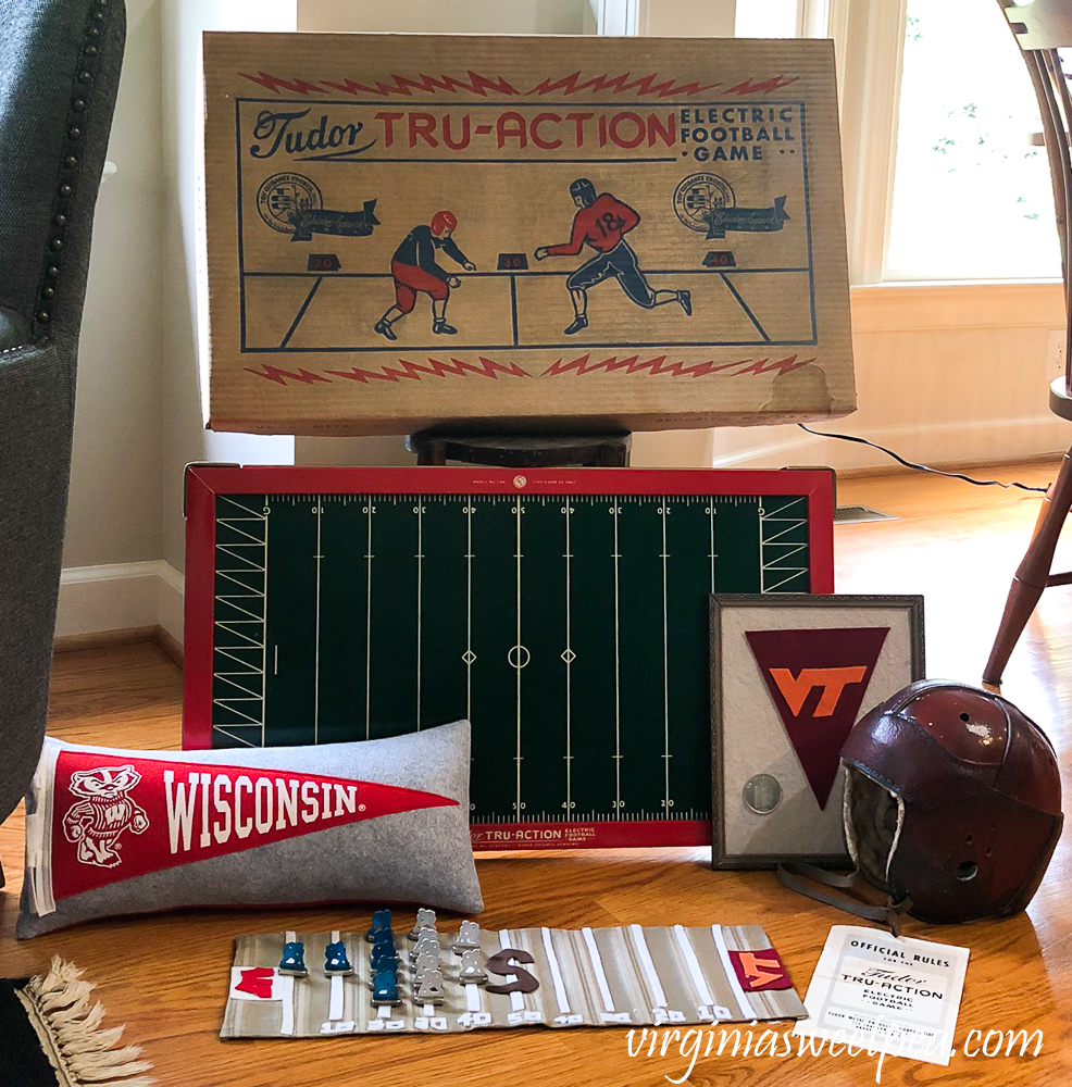 Vintage football display with Tudor Tru-Action Electric football game, 1920s football helmet, Wisconsin pennant pillow
